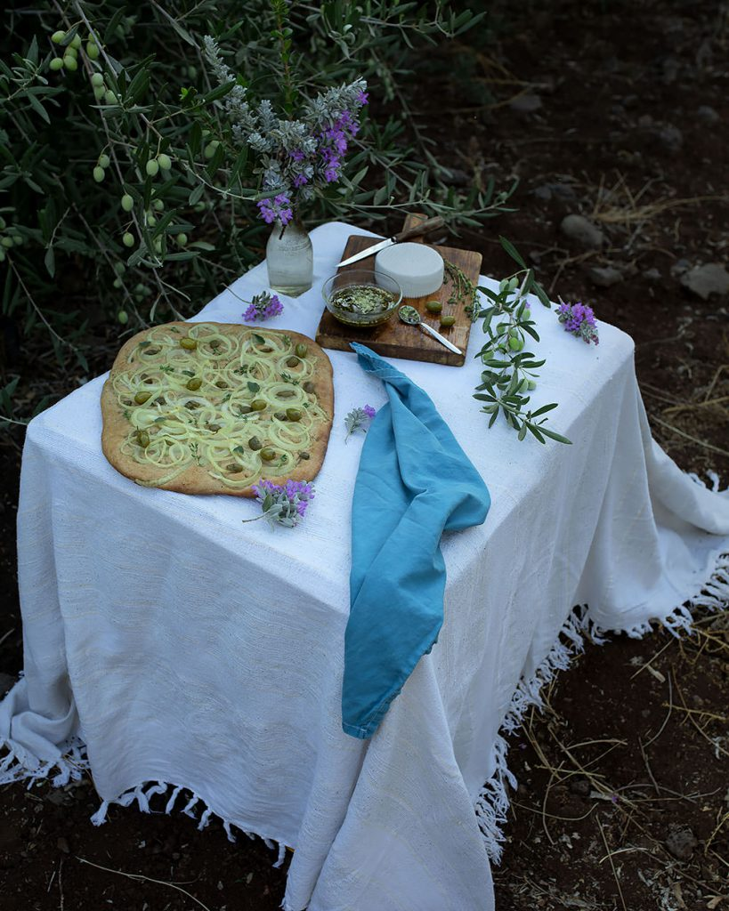 olive and onion focaccia on table
