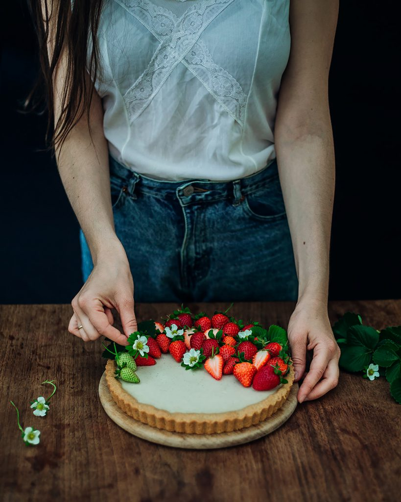 decorating the strawberry mascarpone tart